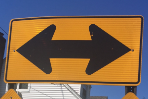 picture of a highway sign depicting two directions traffic can travel