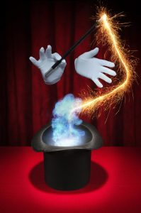 picture of hands in gloves, one holding a wand, simulating a magician. a symbol of AI