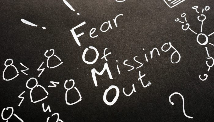 image depicting fear of missing out concept