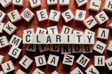 arrangement of scrabble blocks spelling the word clarity